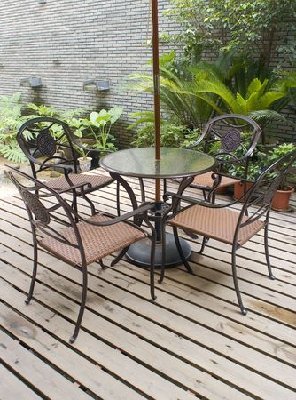 patio with  table and chairs Imagens