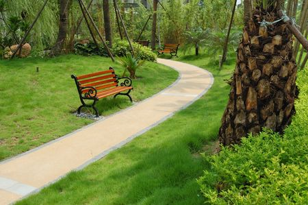 A walkway winding its way through a tranquil garden Stock Photo - 3337810