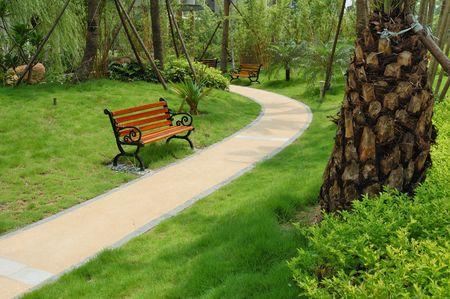 A walkway winding its way through a tranquil garden Stock Photo - 3337810