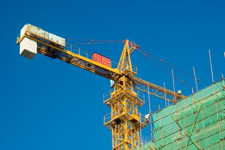 Large crane over a building in construction  photo