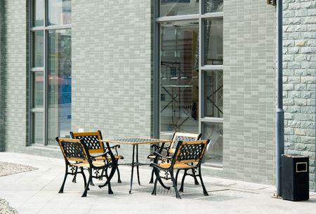 big windows: Street scene with big windows and chair and table