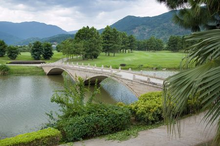 Old style stone bridge on a river,landscape in a new park in China