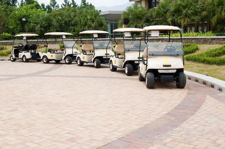 A row of empty golf ts waiting for golfers at a country club