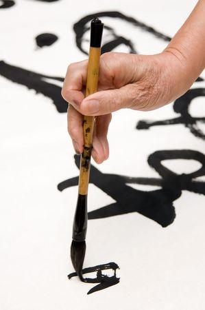 penmanship: A old man writing Chinese calligraphy