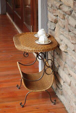 Teacup on the cane end table photo
