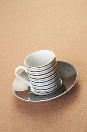 faience: An empty coffee cup on a table.  Stock Photo