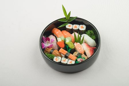 containing: Japanese food containing sushi salmon and vegetables Stock Photo