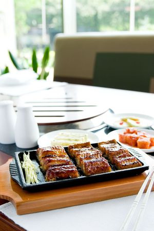 Chinese food,grilled fish in restaurant photo