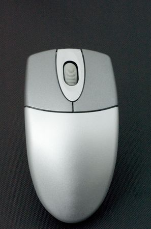 A wireless computer mouse against a black background. Stock Photo - 3709850