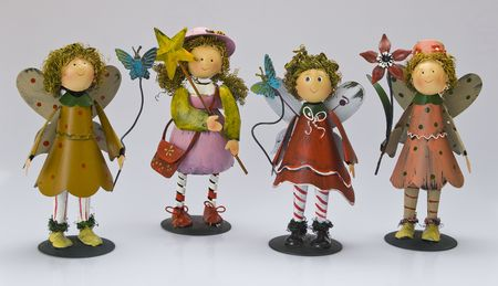 ironwork: Colorful ironwork dolls on the white background in studio