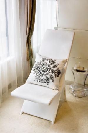 reclining chair: reclining chair near the window  Stock Photo
