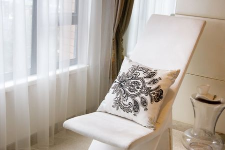 reclining chair near the window  photo