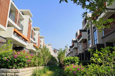 A footpath and two rows of new terrace houses beside it in the southeast of China,these homes are aimed at the normal buyer in China Stock Photo - 3959044