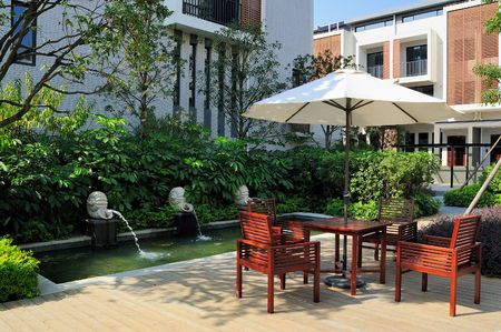 Garden with a fountain and table and chairs photo