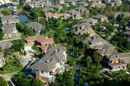 overlooking: Overlooking a neighborhood of residential district with a river through