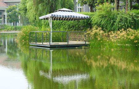 Summer umbrella in the waterside photo
