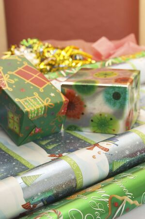 Christmas decoration series,gift boxes and roll of wrapping paper photo