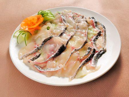 slices of raw fish in studio photo