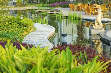 park path: Tranquil Garden with plant and pond in China Stock Photo