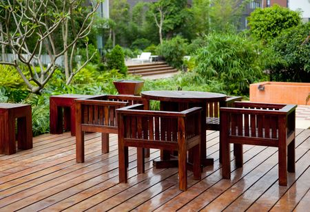 backyards: House patio with wooden table and chairs