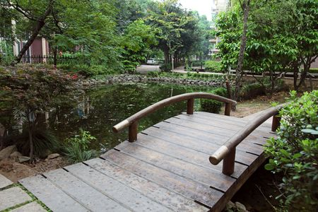 Wooden arched bridge in a chinese garden. photo