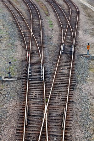 Crossing railroad track and signal lamps in a railway junction. photo