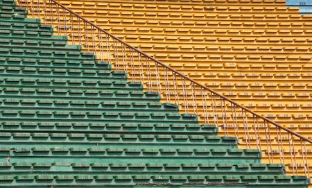 A field of empty white plastic stadium seats. photo