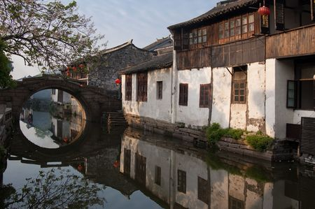 architectural style: Famous water village Zhouzhuang in Jiangsu ,China. The houses  by the river are built several hundred years ago with  a typical architectural style of the Ming and Qing Dynasties