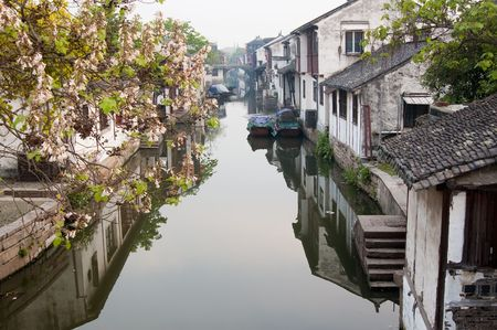 rural town: Famous water village Zhouzhuang in Jiangsu ,China. The houses  by the river are built several hundred years ago with  a typical architectural style of the Ming and Qing Dynasties