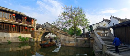 Famous water village Zhouzhuang in Jiangsu ,China. The houses  by the river are built several hundred years ago with  a typical architectural style of the Ming and Qing Dynasties. Panorama shot by 5 pictures. photo