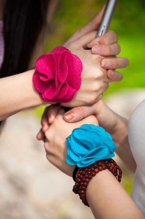 holding hands with corsages, symbolizing friendship or love photo