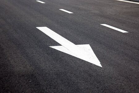 fork in the road: Traffic Signal,go straight  signs arrows on asphalted surface Stock Photo