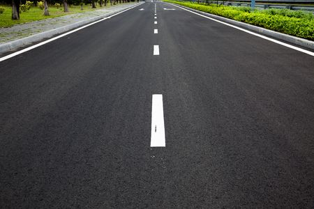 rules of the road: Empty highway with road signs arrows on asphalted surface