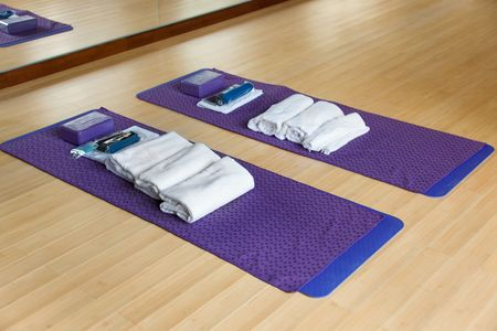 Gym with mat and other exercising materials prepared for yoga photo