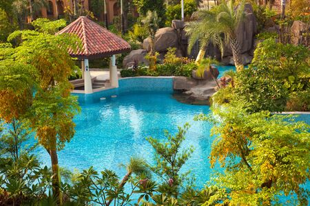 Swimming pool and trees in the garden in a new Chinese residential district photo