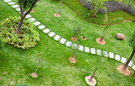 Stepping stones through a  tranquil garden in China Stock Photo - 5969414