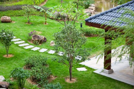 road paving: Gazebo and footpath landscaping  in a beautiful garden Stock Photo