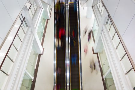 Motion blurred people on stairs and escalator  photo