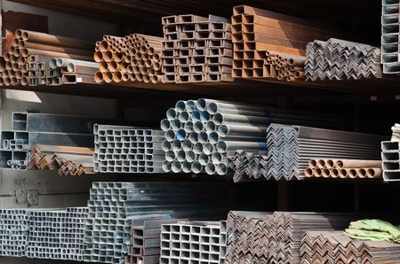 stainless steel background: A series of different sizes metal pipes on  shelf