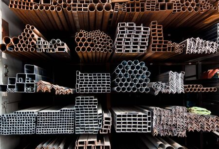 steel factory: A series of different sizes metal pipes on  shelf