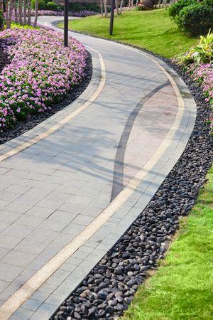 A  walkway winding its way through a tranquil garden.  photo