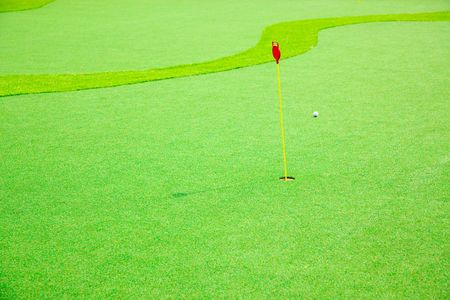 driving range: Hole with the flag in a Driving Range Stock Photo