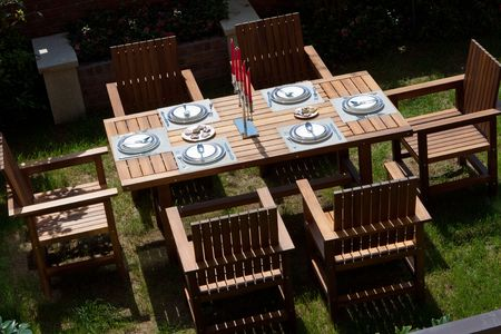 balconies: Table setting in a backyard patio Stock Photo
