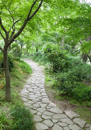 The footpath winding its way through a tranquil garden. Stock Photo