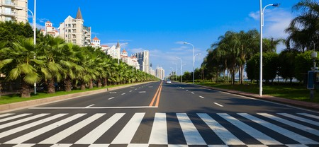 lane lines: Cityscape of asian city viewed from zebra or pedestrian crossing Stock Photo