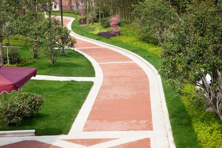 A brick walkway winding its way through a tranquil garden. Processed from a 16 bit RAW files  in  Adobe RGB   colour space and professionally retouched to achieve the best image quality. photo