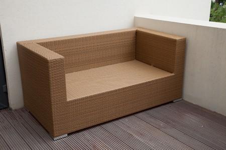 Wicker sofa in yard photo