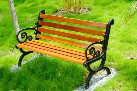 garden bench: Wooden park bench at a park in China
