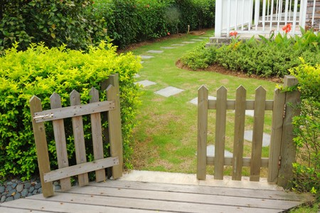 home garden: Open wooden gate and fence in yard
