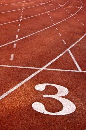 Lanes of a red race track with numbers photo